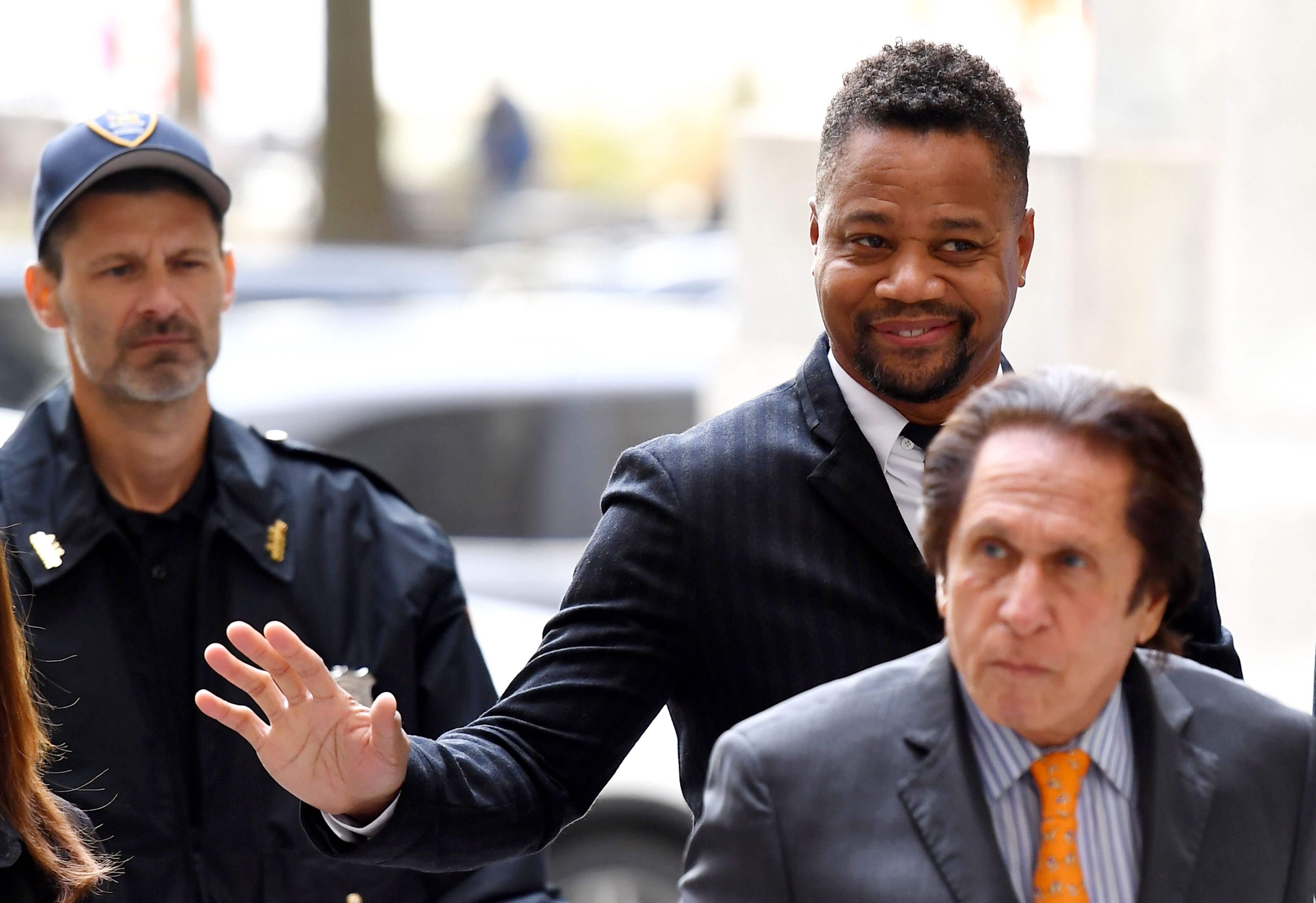 Cuba Gooding Jr. appeared in court for the start of his groping trial, but it was later delayed as he faces a new charge, which will soon be identified.