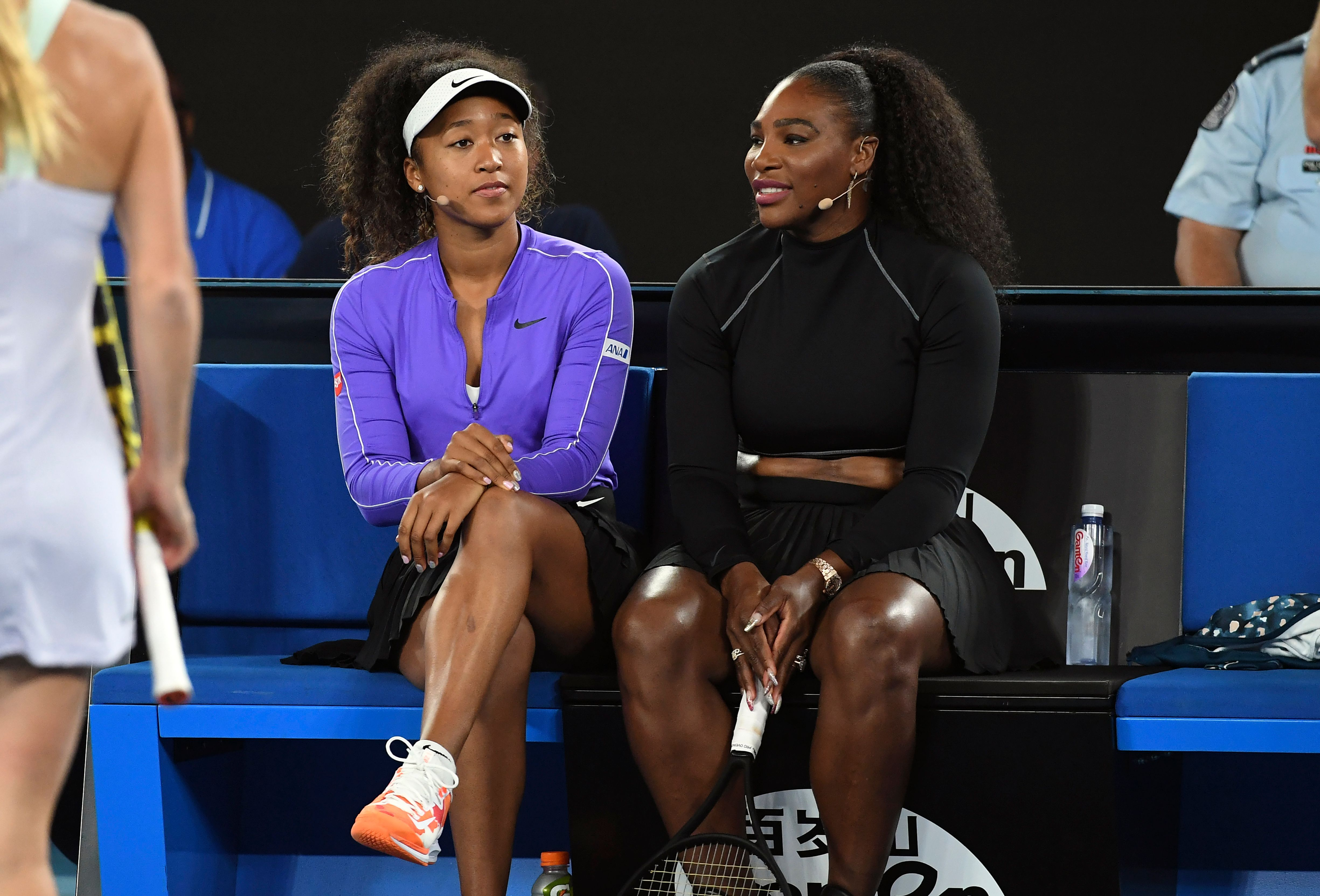 Tennis player Naomi Osaka claps back at two fans after they criticize her for calling Serena Williams her mom in a new Instagram post.